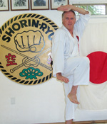 Sensei Barnhart performing Kata. Sensei Barnhart majored in Computers and minored in physics. He easily explains technique and the economy of movement.