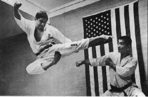 Master Ansei Ueshiro performing a flying kick.